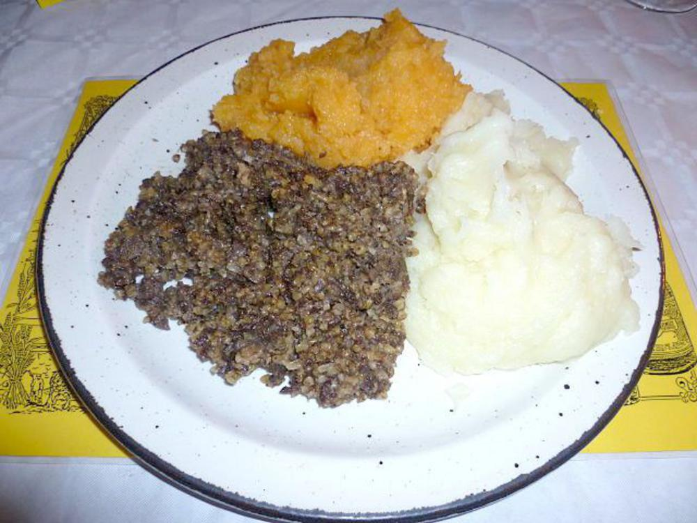 Haggis served wi tatties an neeps (with potatoes and turnips)