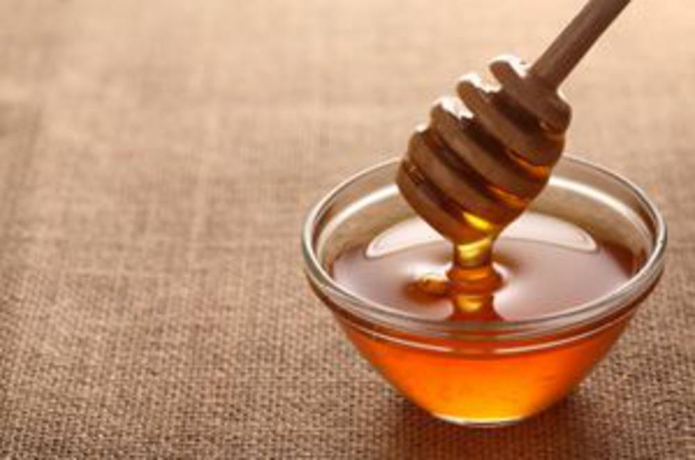Honey with dipping stick