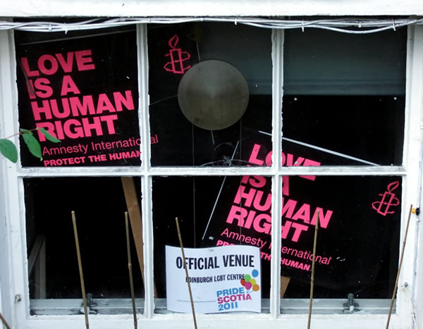 Placards on human rights in a basement window