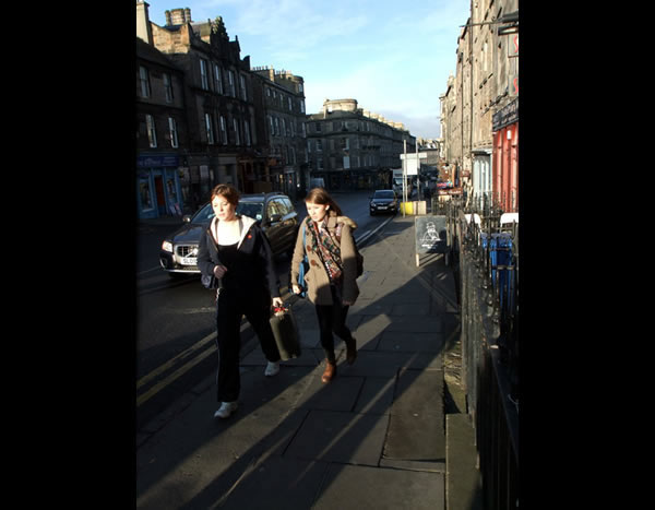 People walking up Broughton Street